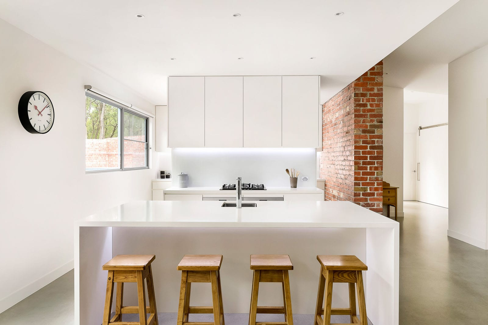Kitchen with recycled brick feature