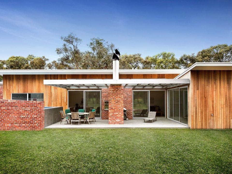 Custom home with balcony sitting arrangement