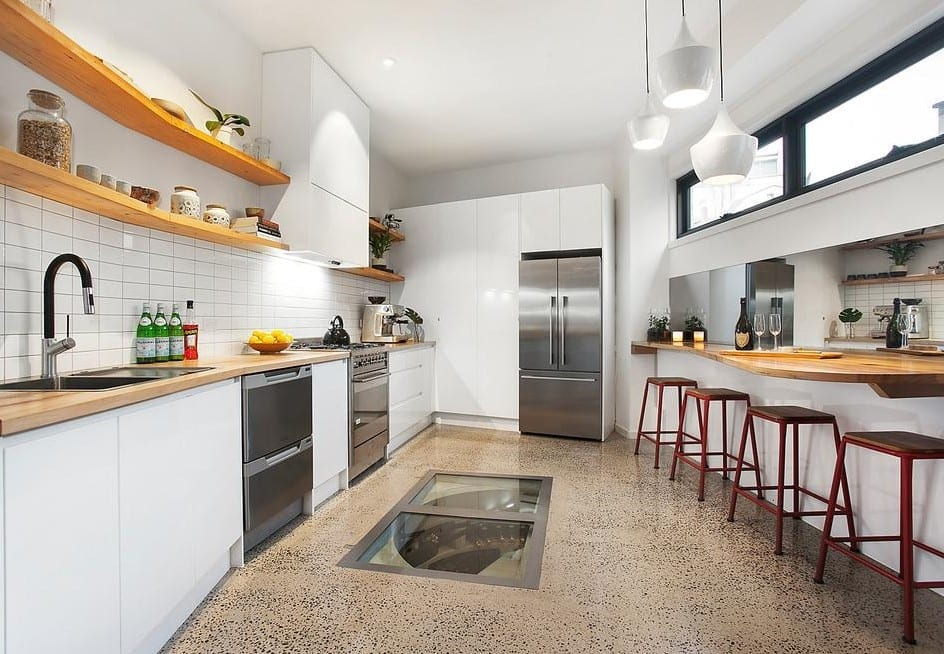 diner style kitchen with a wine cellar trap door